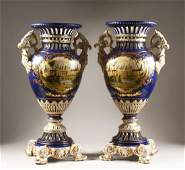 A LARGE PAIR OF SEVRES DESIGN BLUE GROUND TWO HANDLED