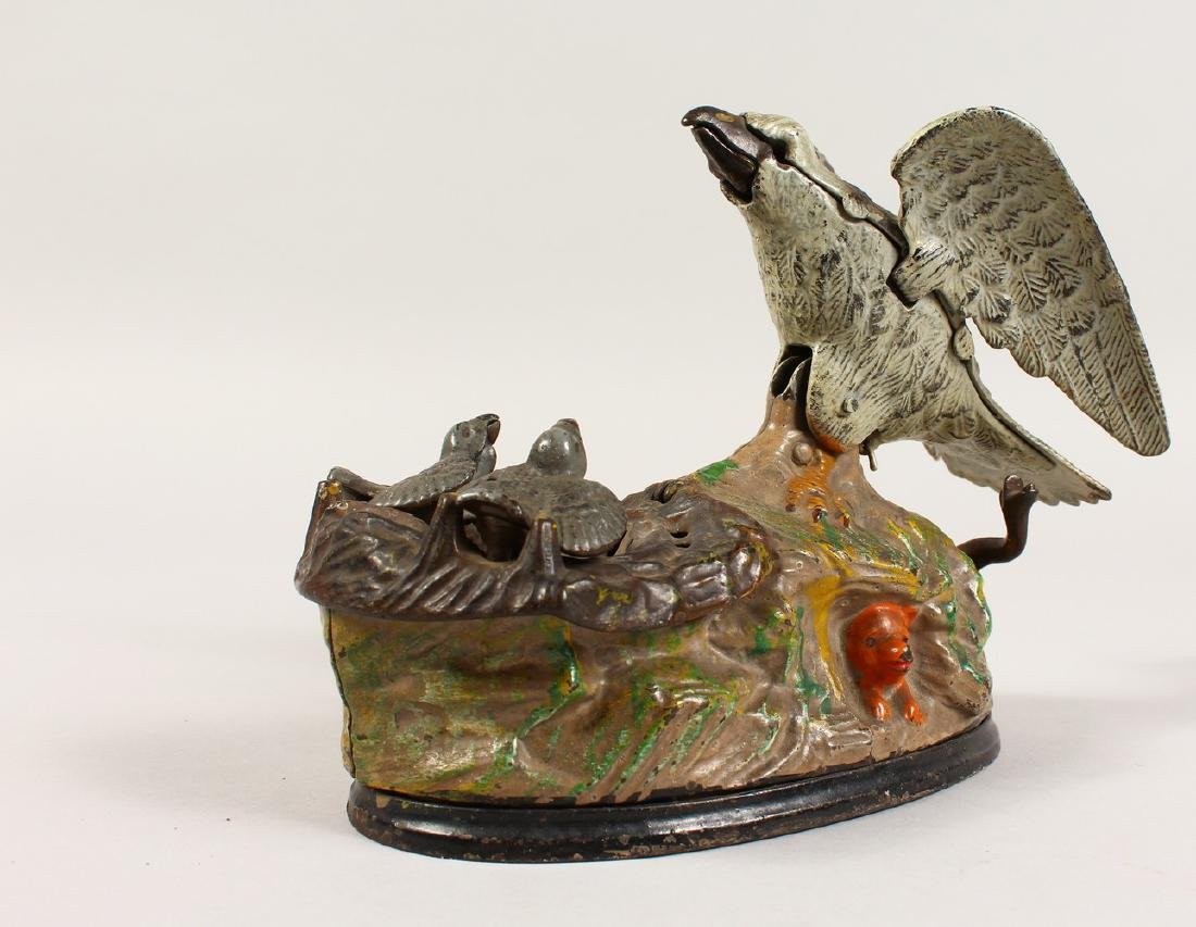 AN EAGLE AND EAGLET CAST IRON MECHANICAL BANK, 1883,