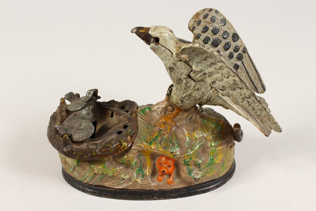 AN EAGLE AND EAGLET CAST IRON MECHANICAL BANK, 1883, - 2