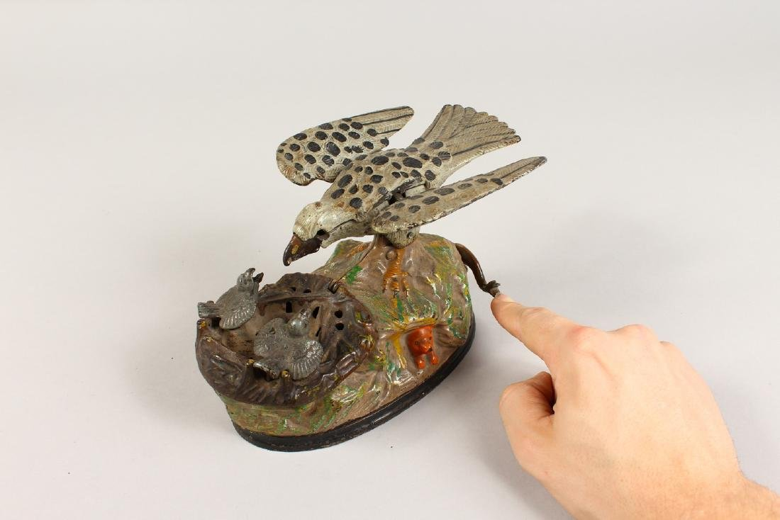 AN EAGLE AND EAGLET CAST IRON MECHANICAL BANK, 1883, - 8