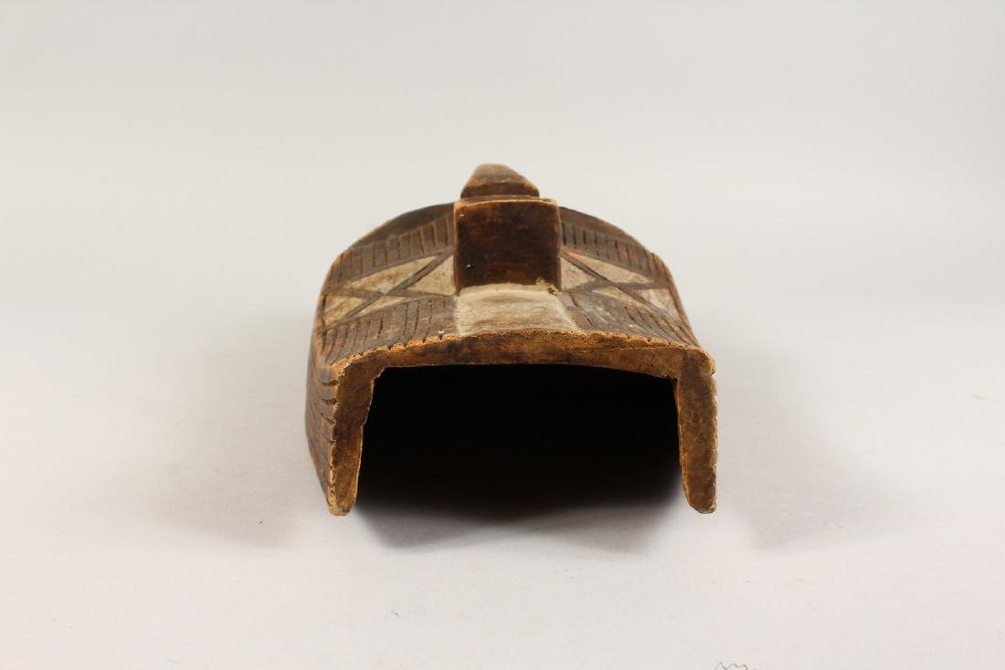 A CASED WOOD TRIBAL MASK, with incised and painted - 4