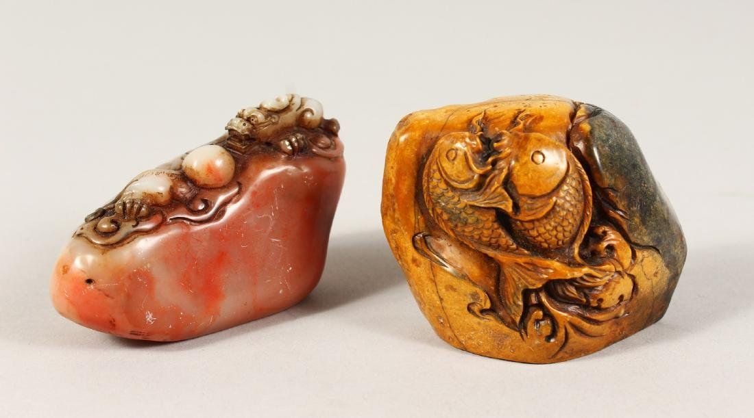 TWO CARVED CHINESE SOAPSTONE SEALS.
