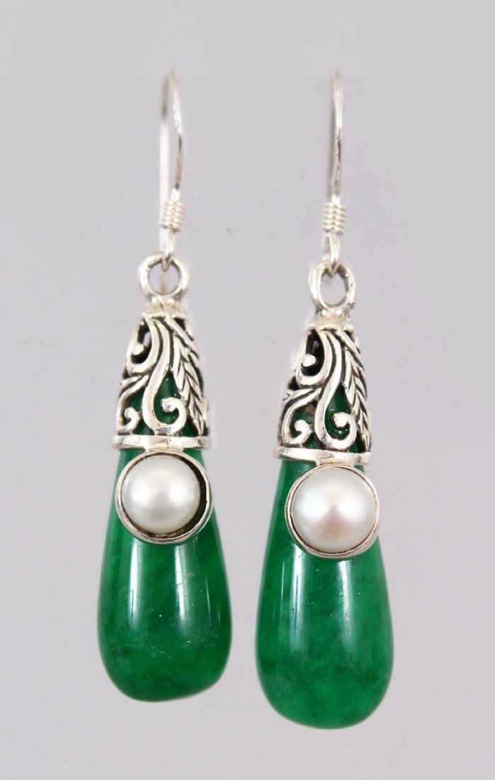 A PAIR OF SILVER AND JADE DROP EARRINGS.