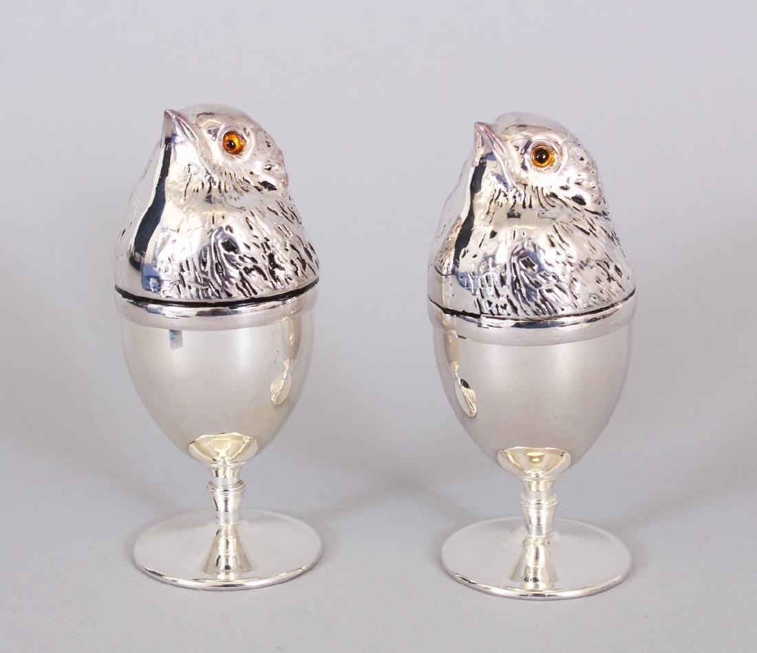 A PAIR OF CHICK PLATE EGG CUP WARMERS.