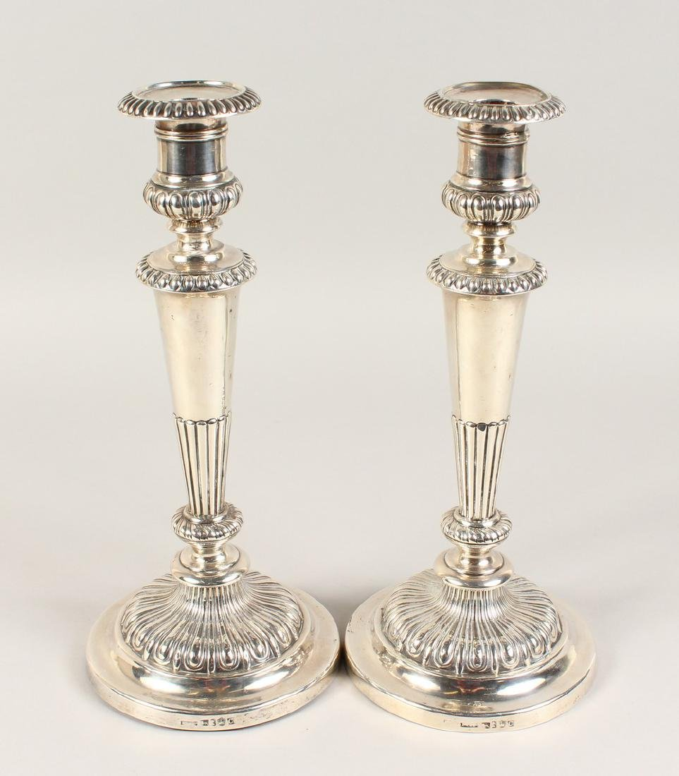 A GOOD PAIR OF GEORGE III CIRCULAR CANDLESTICKS, with