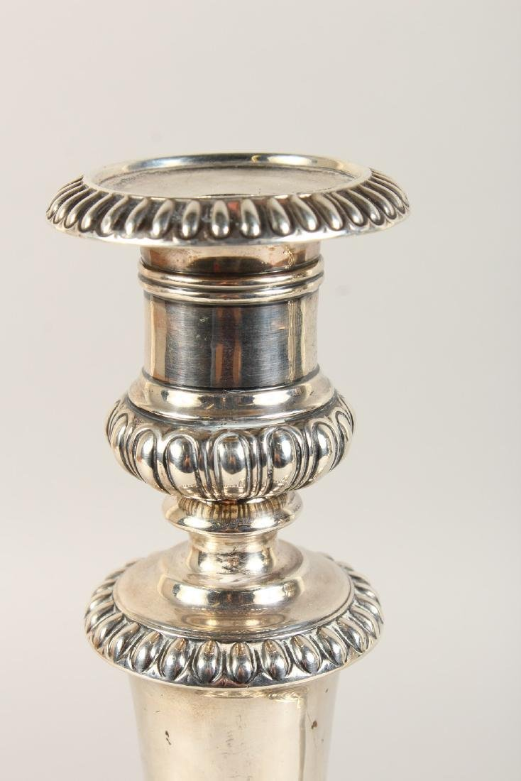 A GOOD PAIR OF GEORGE III CIRCULAR CANDLESTICKS, with - 2