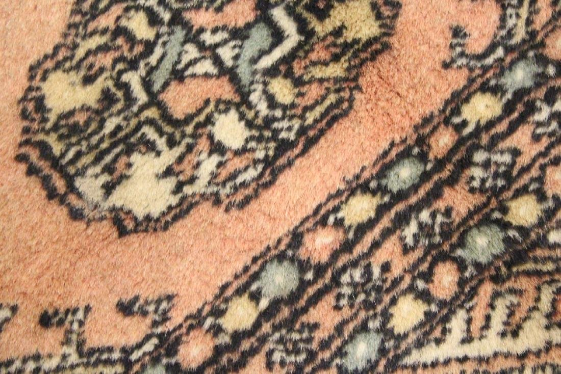 A SMALL BOKHARA RUG, peach ground with two rows of six - 4