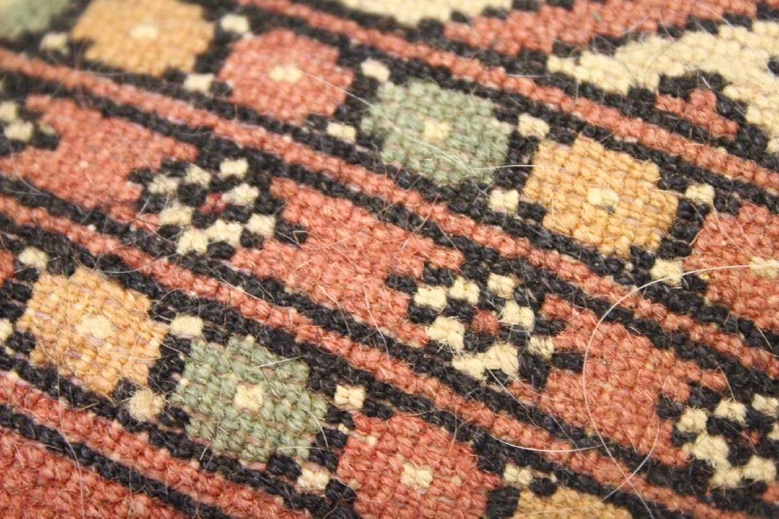A SMALL BOKHARA RUG, peach ground with two rows of six - 6