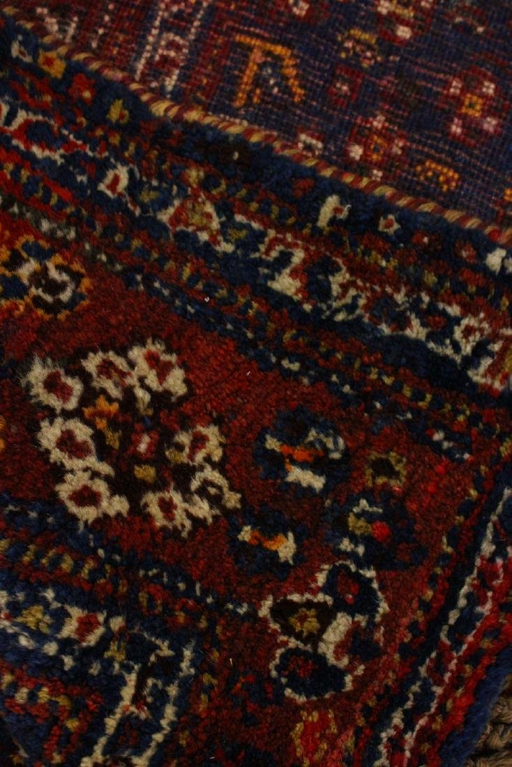 A PERSIAN CARPET, blue and red ground, decorated with - 2