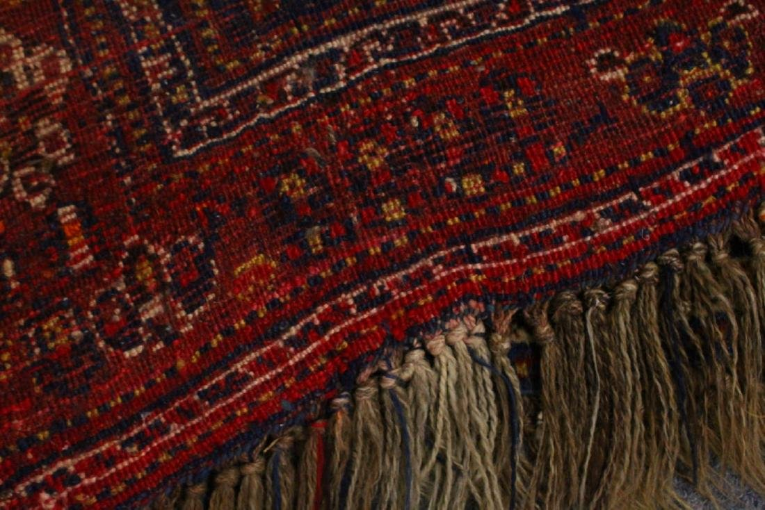 A PERSIAN CARPET, blue and red ground, decorated with - 4