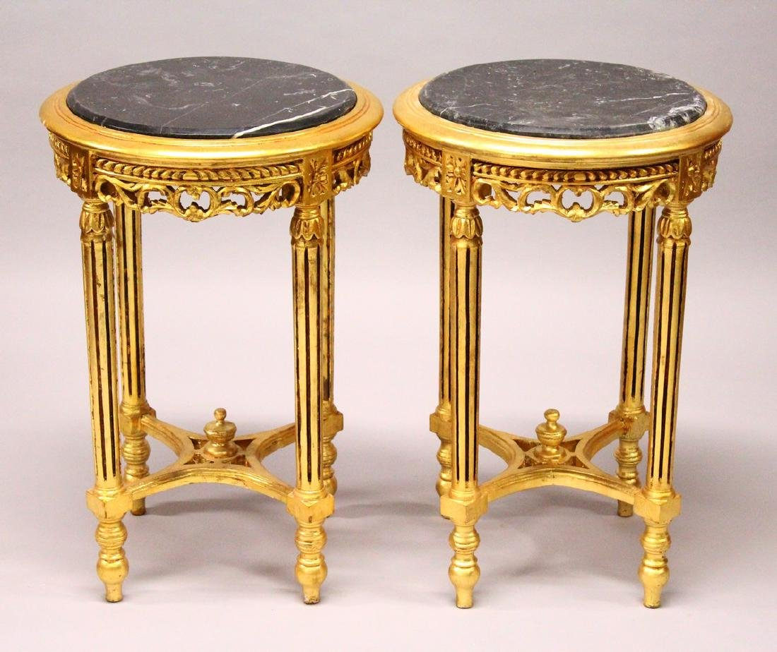 A PAIR OF FRENCH STYLE GILTWOOD CIRCULAR STANDS, inset