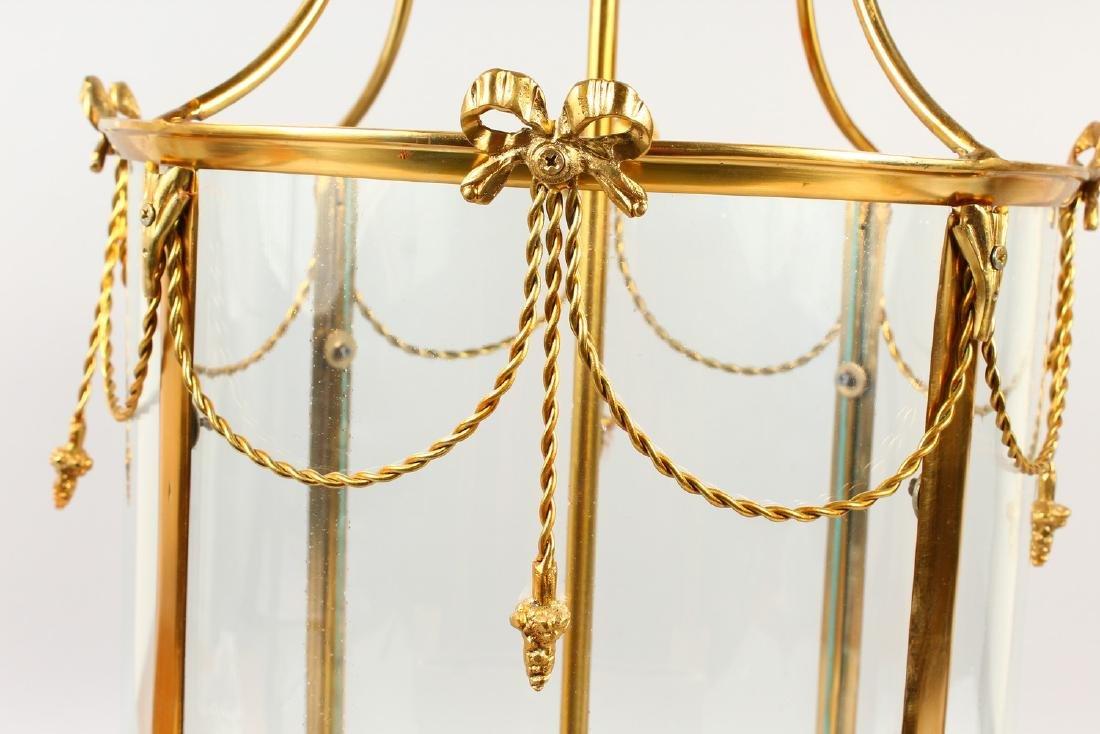 A GEORGIAN STYLE BRASS AND GLASS HALL LANTERN.  32ins - 2