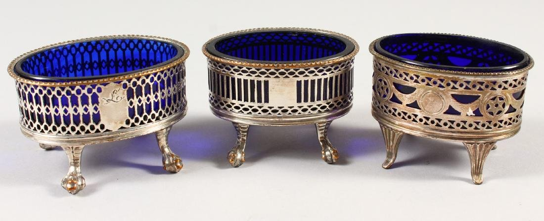 THREE OLD SHEFFIELD PLATE PIERCED SALTS with blue glass