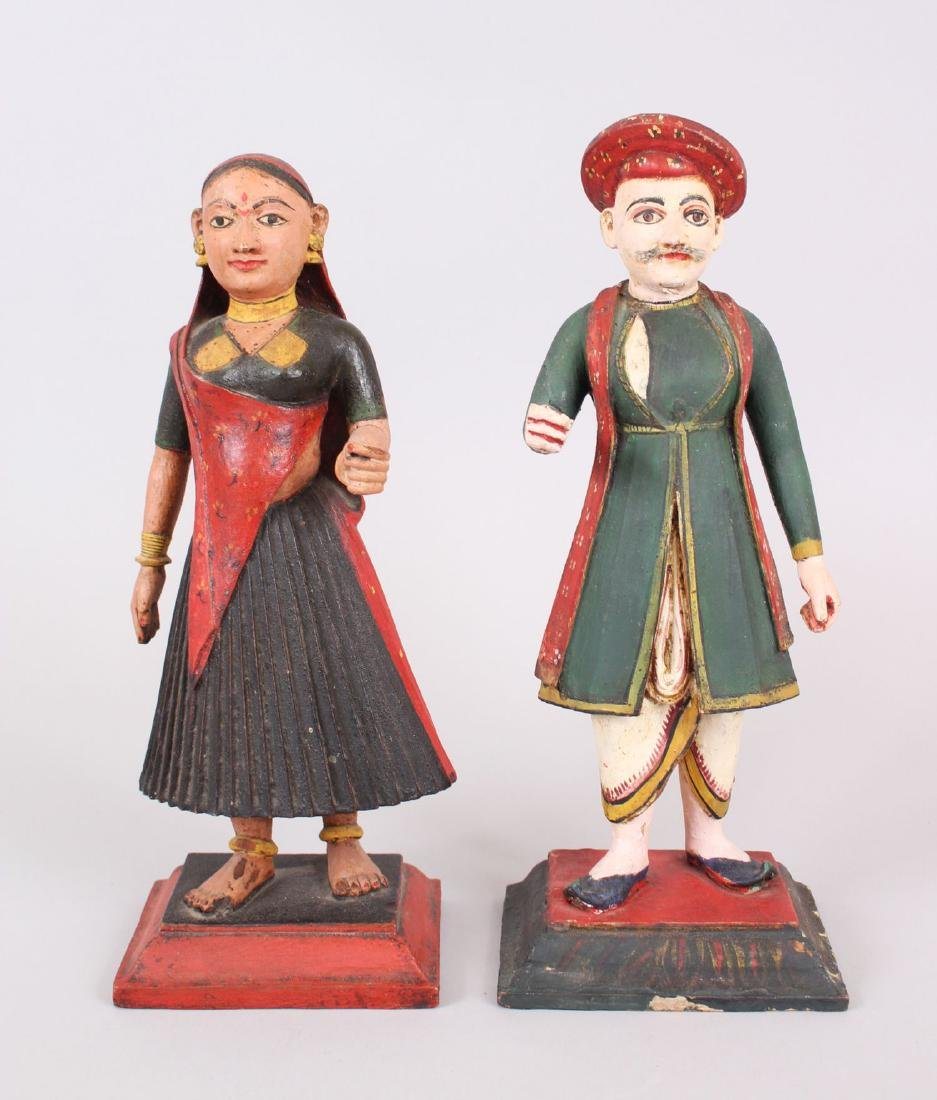 A RARE PAIR OF 19TH CENTURY INDIAN CARVED WOOD AND