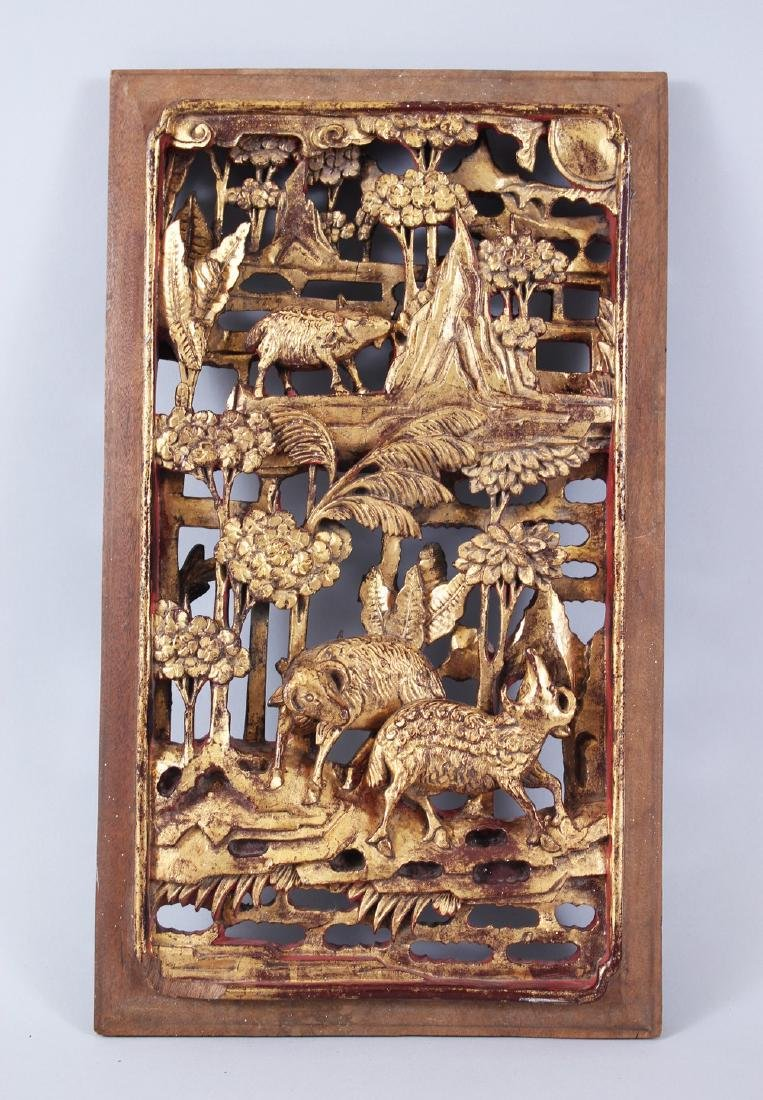 A 19TH CENTURY CHINESE GILT WOOD PANEL, with carved