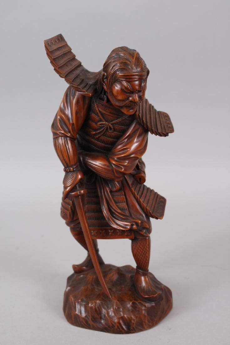 A GOOD JAPANESE MEIJI PERIOD CARVED WOOD OKIMONO OF A