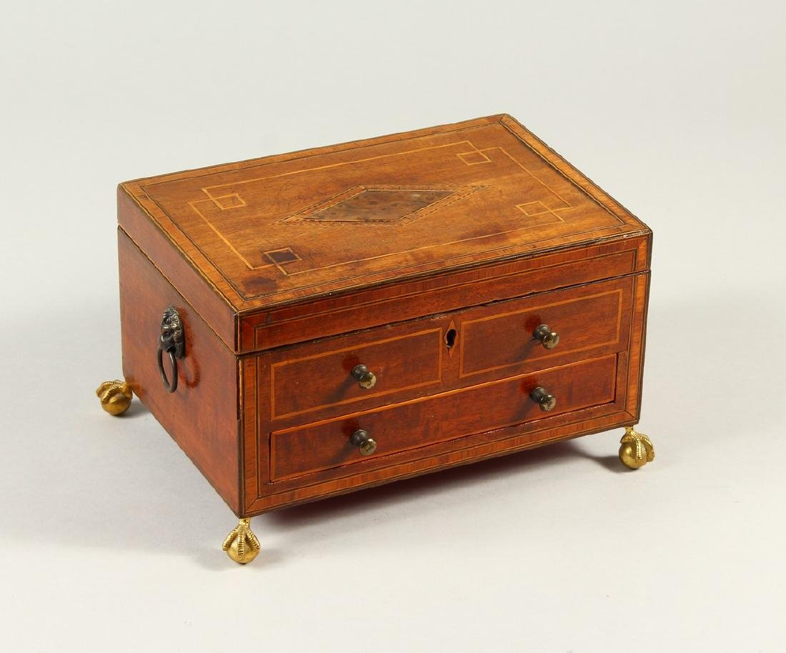 A GEORGE III INLAID MAHOGANY WRITING BOX, with a small