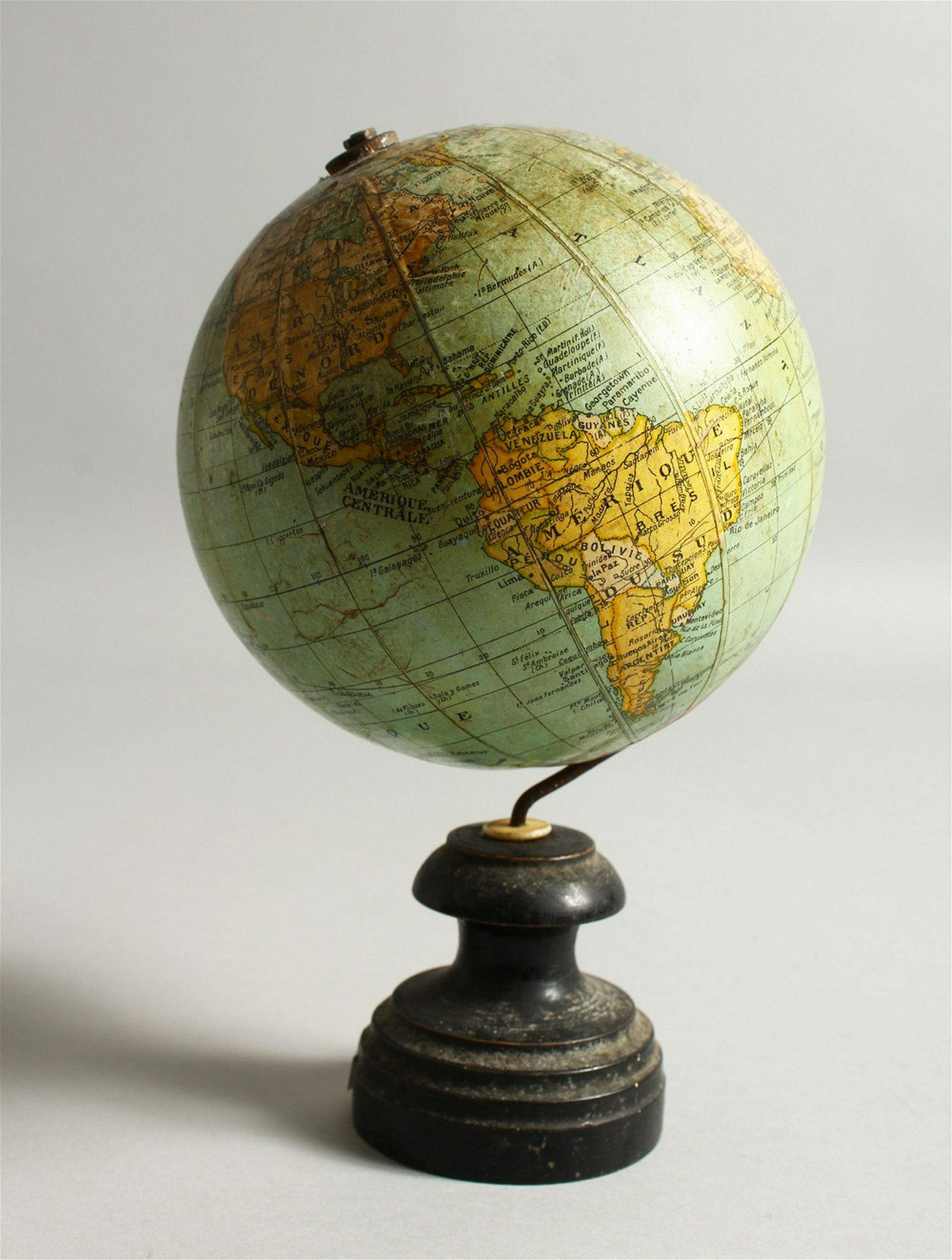 A SMALL TERRESTRIAL GLOBE, on turned wood stand.  20cms