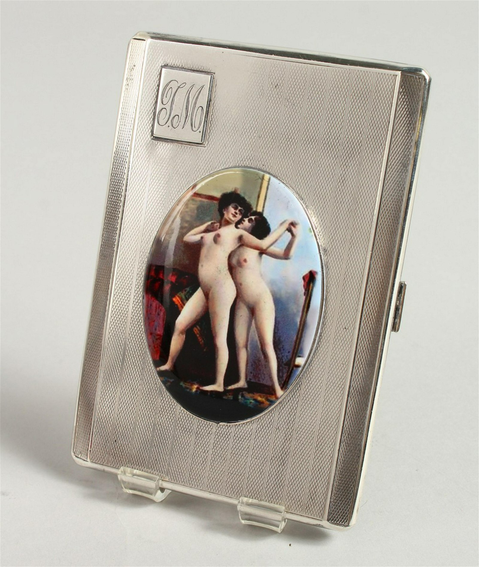 AN ENGINE TURNED CIGARETTE CASE, with an enamel oval of
