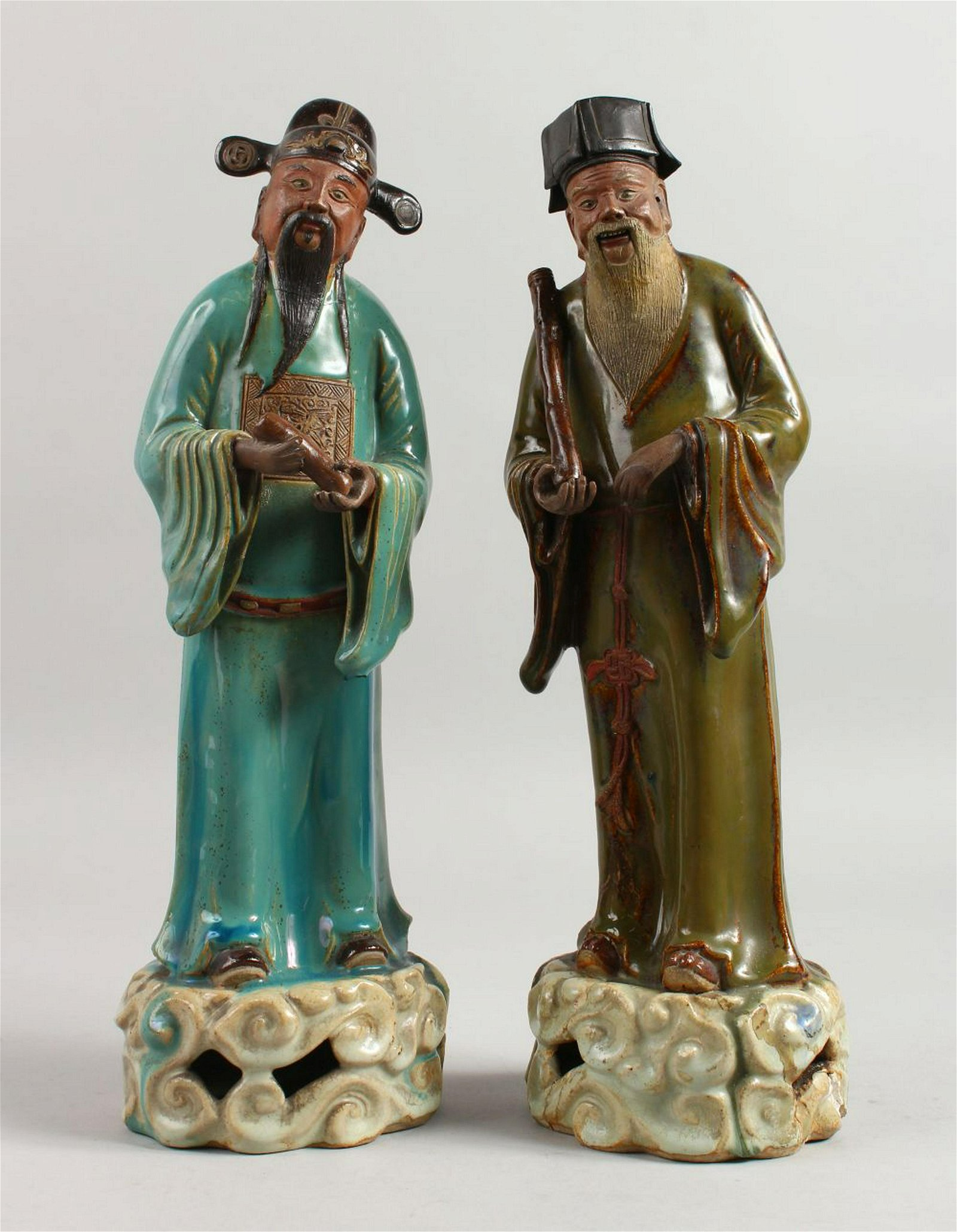 A PAIR OF 19TH CENTURY CHINESE POTTERY SCHOLARS.  15ins