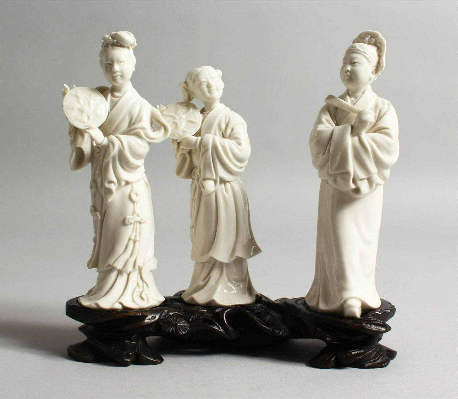 A SET OF THREE CHINESE BLANC DE CHINE FIGURES on a