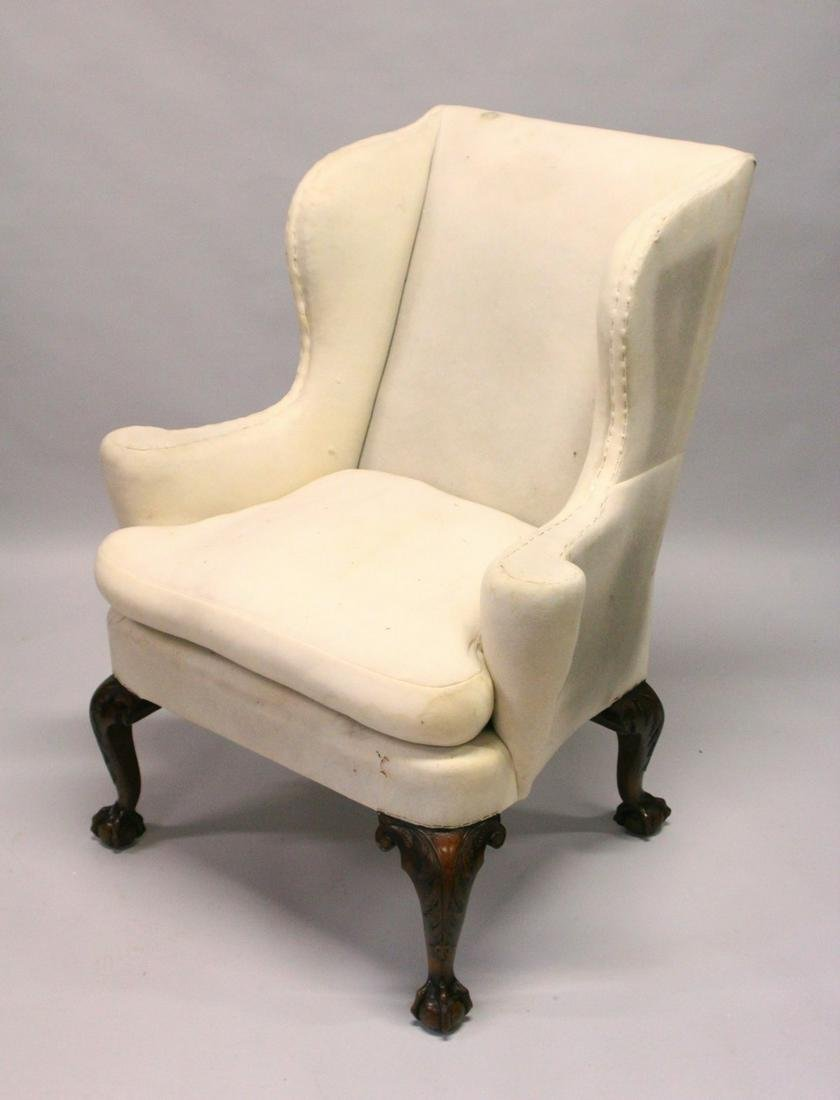 A GEORGE III DESIGN WALNUT WING ARMCHAIR, with carved