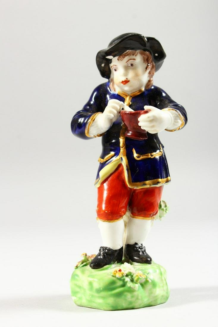 A SMALL DERBY PORCELAIN FIGURE OF WINTER, a boy eating