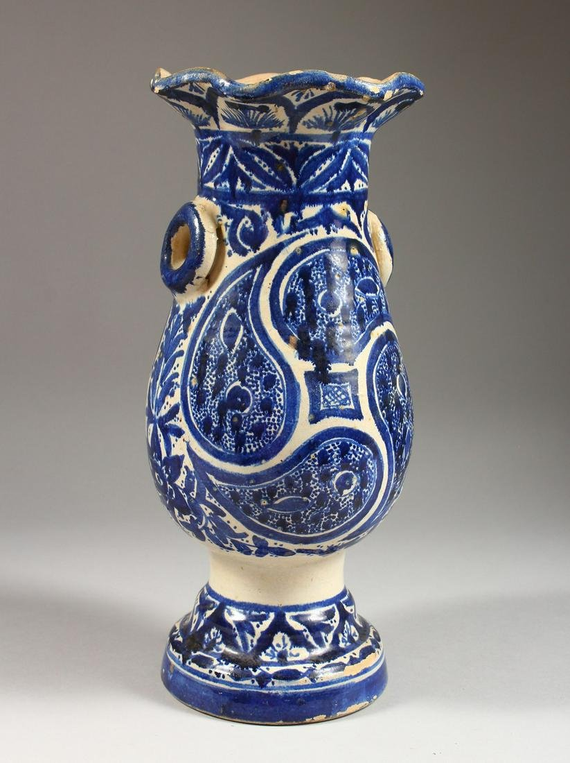 AN ISLAMIC BALUSTER SHAPED POTTERY VASE, with stylised