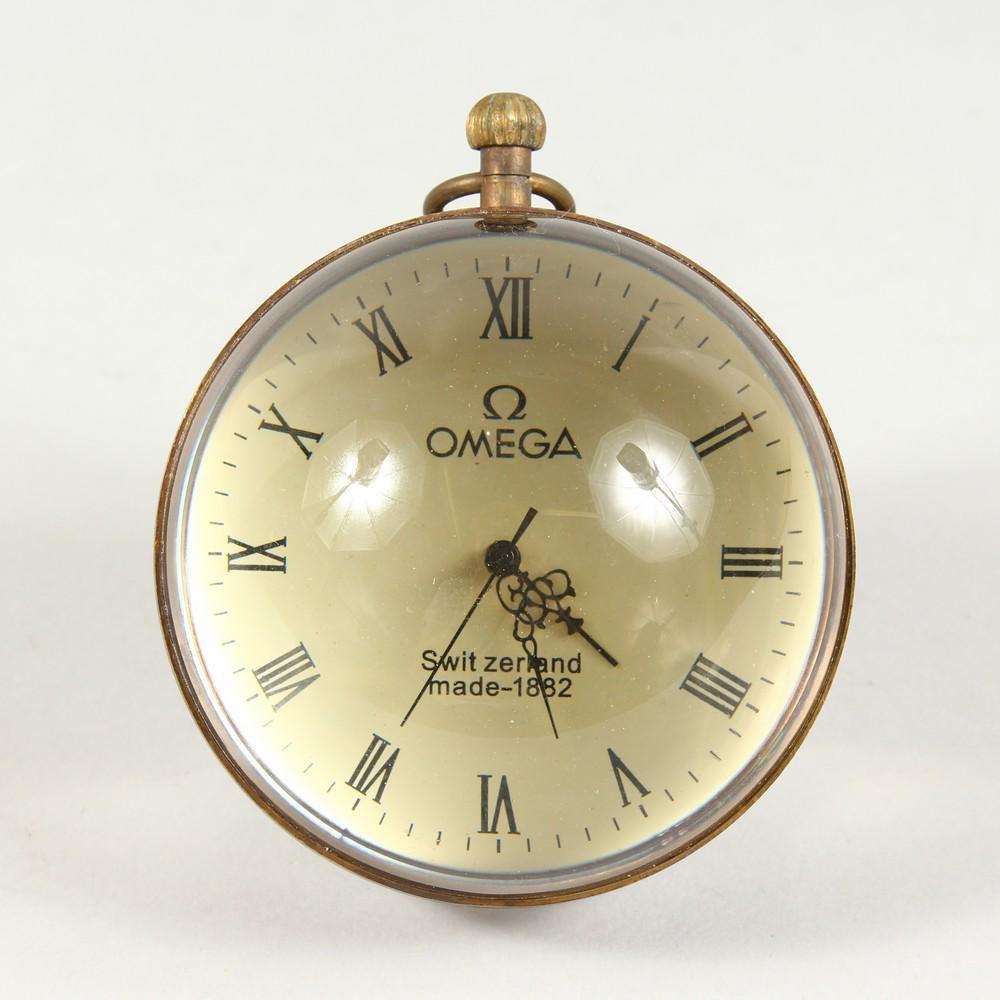A NOVELTY BALL SHAPED DESK CLOCK.  3ins diameter.