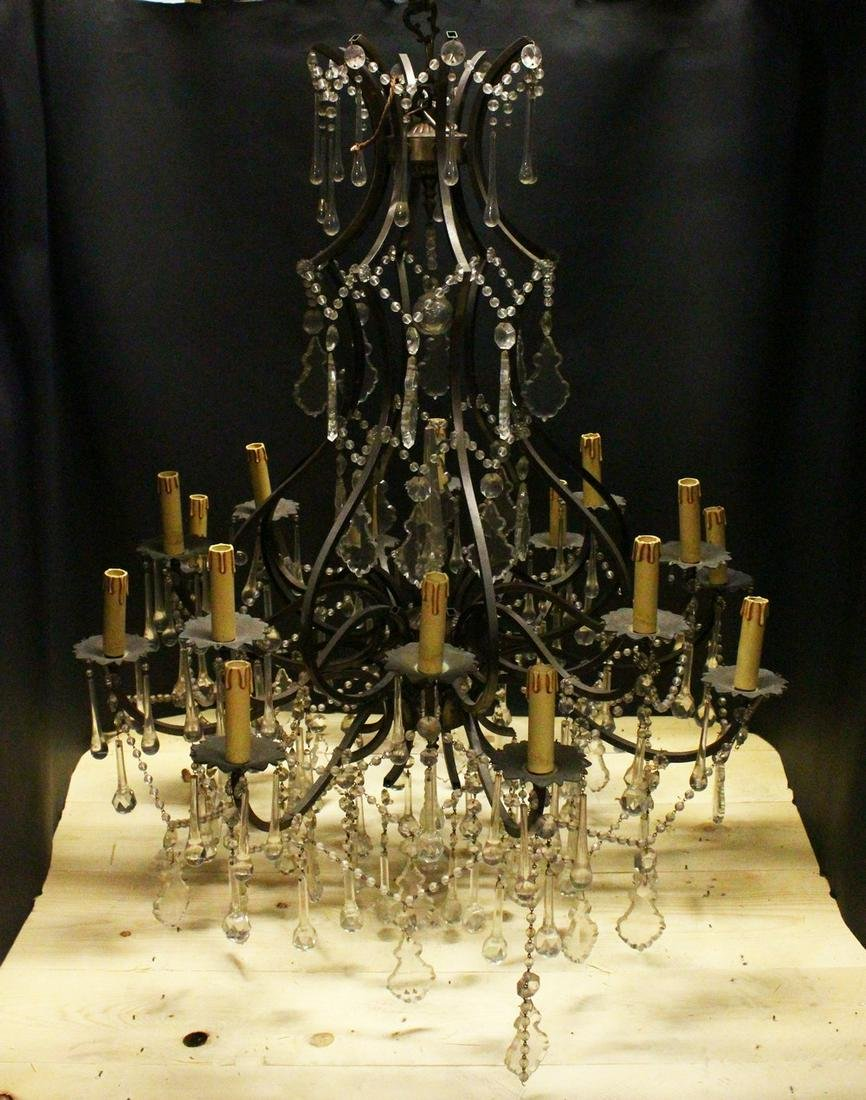 A GOOD LARGE PATINATED BRASS AND CUT GLASS CHANDELIER,