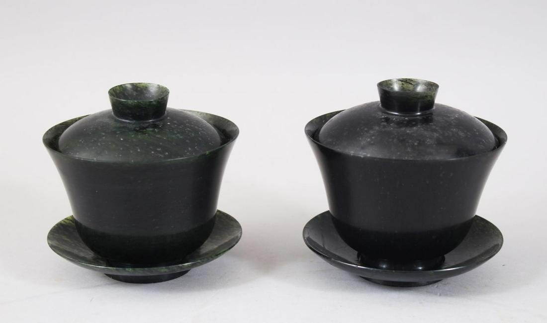 A GOOD PAIR OF CHINESE SPINACH JADE TEA CUP SETS /