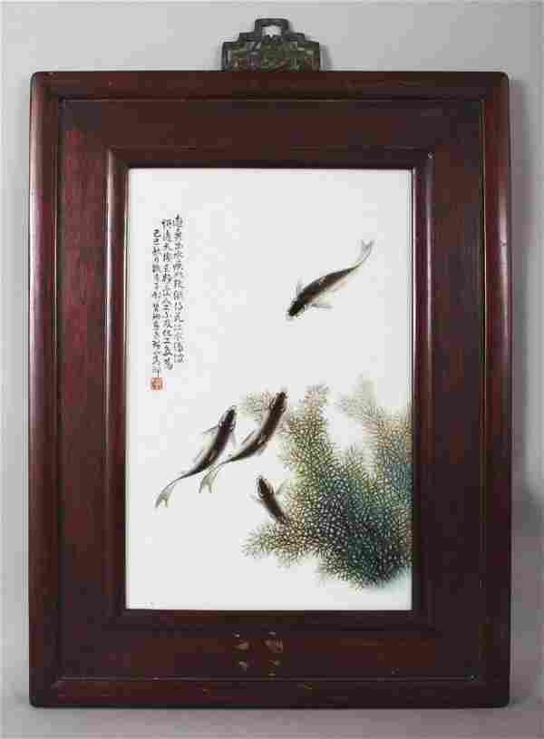 A CHINESE WOOD FRAMED PORCELAIN PLAQUE IN THE MANNER OF