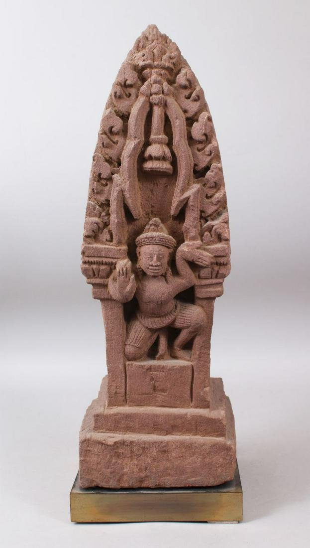 A CAMBODIAN KHMER STYLE CARVING OF A CROUCHING FIGURE