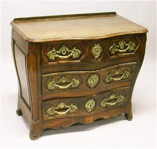 A LOUIS XV STYLE FRENCH OAK SERPENTINE FRONT COMMODE,