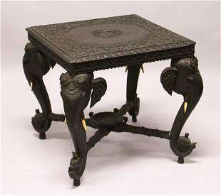 AN EARLY 20TH CENTURY CEYLONESE CARVED EBONY LOW TABLE,