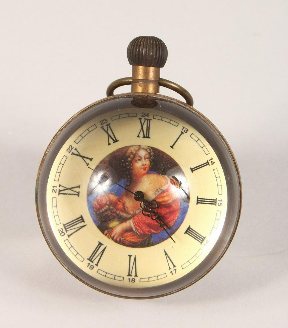 A NOVELTY BALL SHAPED DESK CLOCK, with portrait bust.