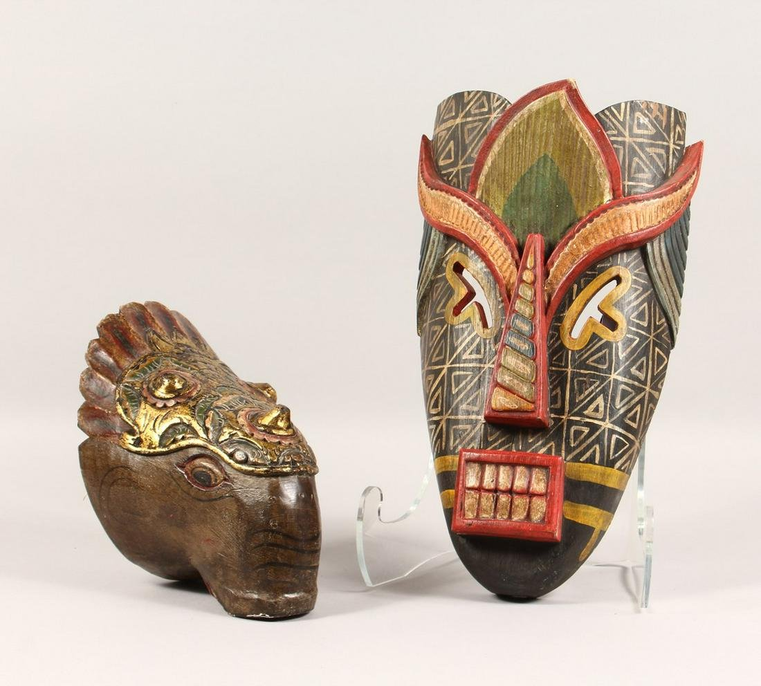 TWO CARVED WOOD AND PAINTED MASKS, one tribal style,