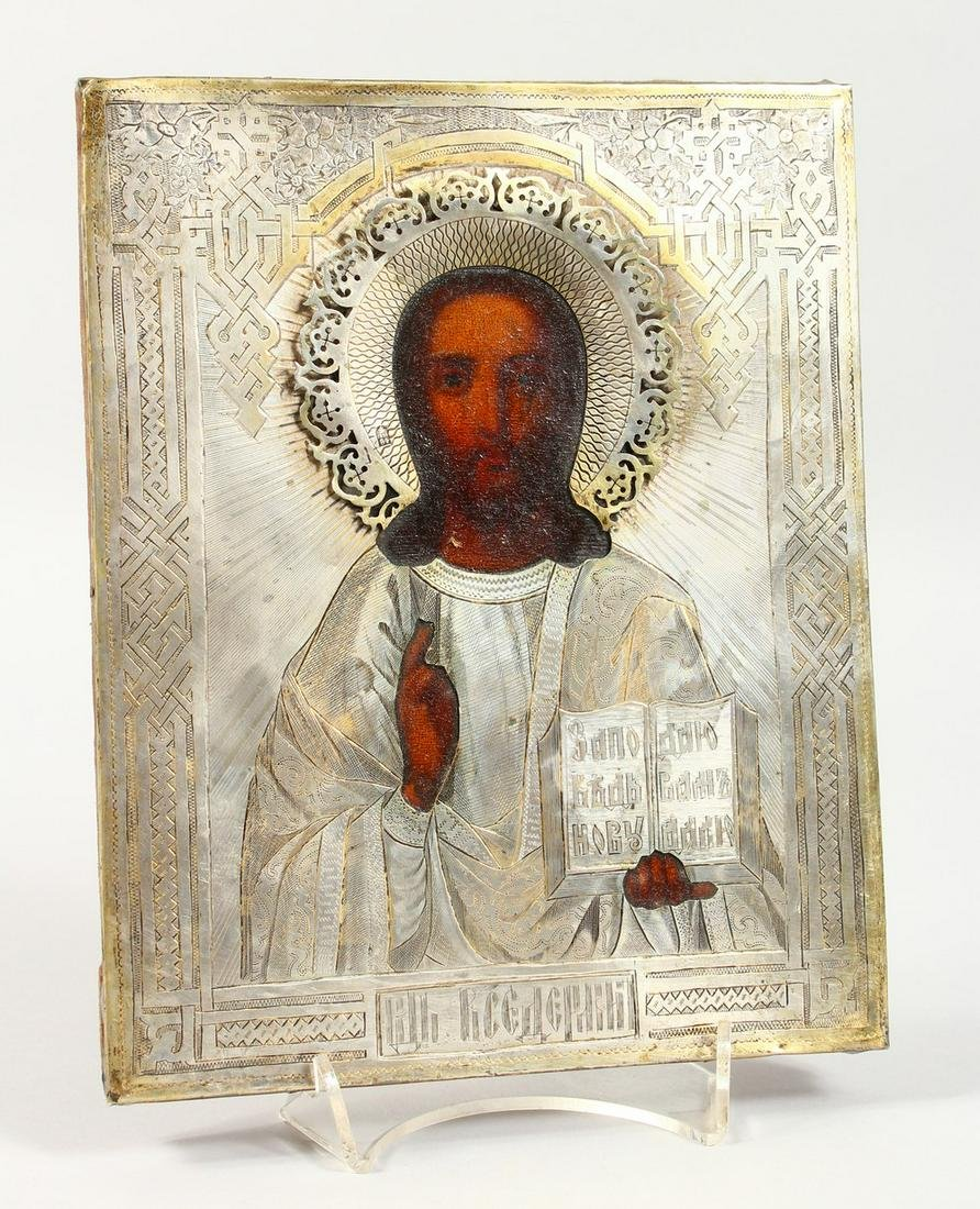 A RUSSIAN ICON, with silver overlay.  Maker: N.K. 1882.