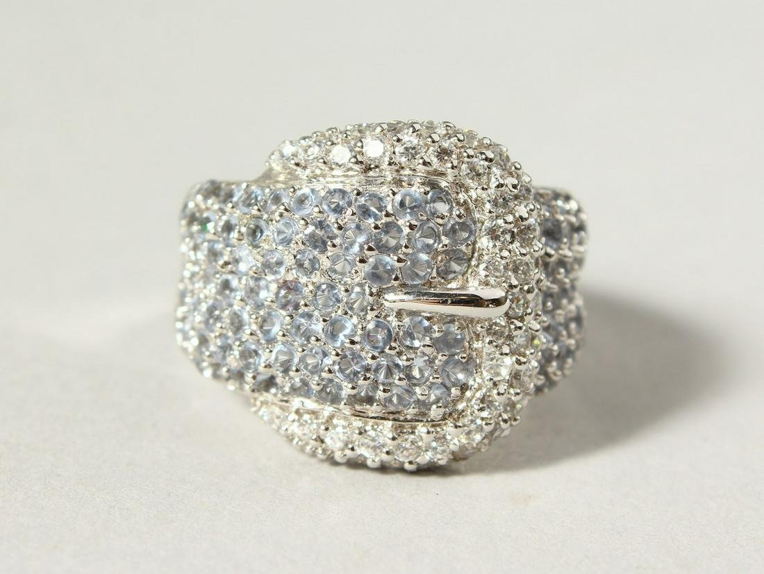 A LARGE SILVER CZ SET BUCKLE RING.