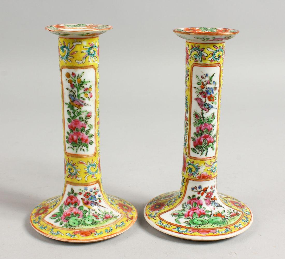 A GOOD PAIR OF CANTON FAMILLE JAUNE CANDLESTICKS with