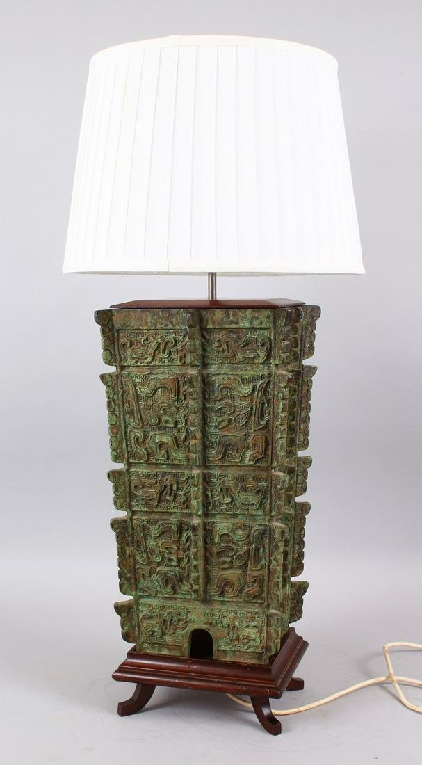 A 20TH CENTURY CHINESE ARCHAIC STYLE BRONZE LAMP, the