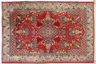 A PERSIAN ISFAHAN CARPET red ground with central