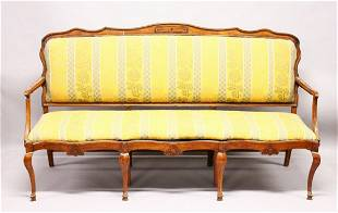 AN 18TH CENTURY STYLE CONTINENTAL WALNUT FRAMED SETTEE
