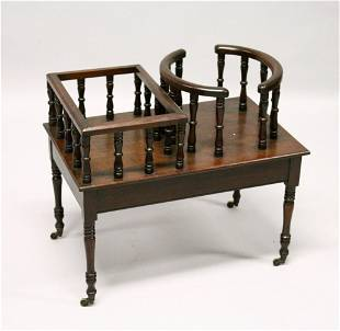 A GEORGE III DESIGN MAHOGANY PLATE AND DECANTER STAND