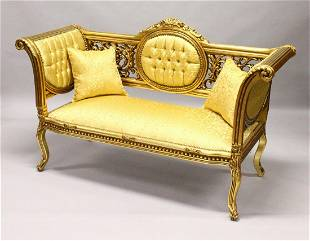 A FRENCH STYLE GILTWOOD SOFA upholstered in a