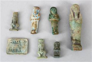 A LOT OF SEVEN EARLY CHINESE POTTERY FIGURES 10cm high