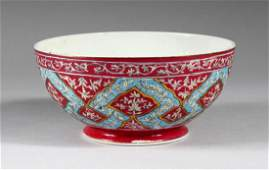 A 20TH CENTURY QAJAR PORCELAIN BOWL, with pink, blue