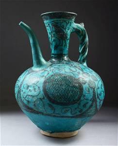 A SUPERB 13TH CENTURY RAQQA SYRIA POTTERY EWER, of