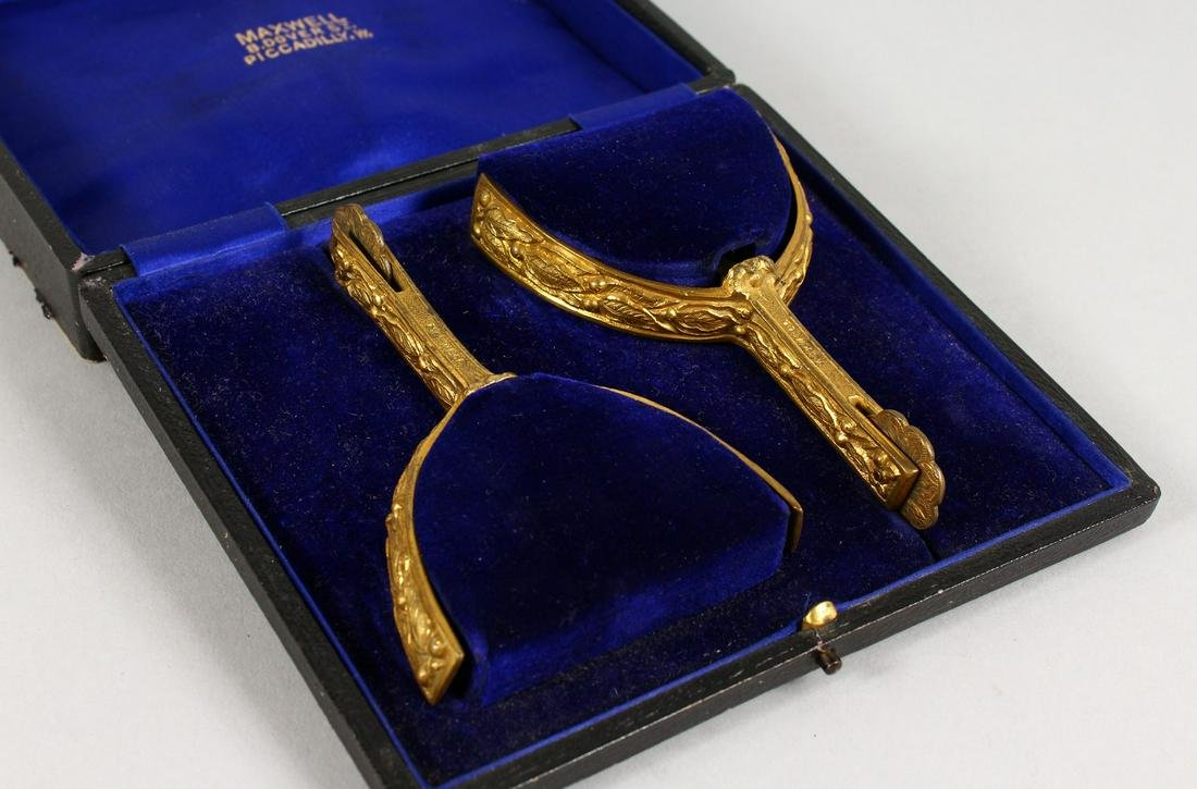 A PAIR OF ORMOLU STIRRUPS, in a fitted box, labelled