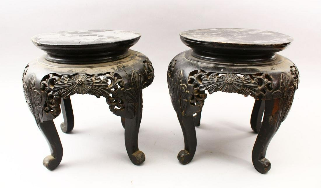 A PAIR OF 19TH CENTURY ORIENTAL HARDWOOD CARVED STANDS,